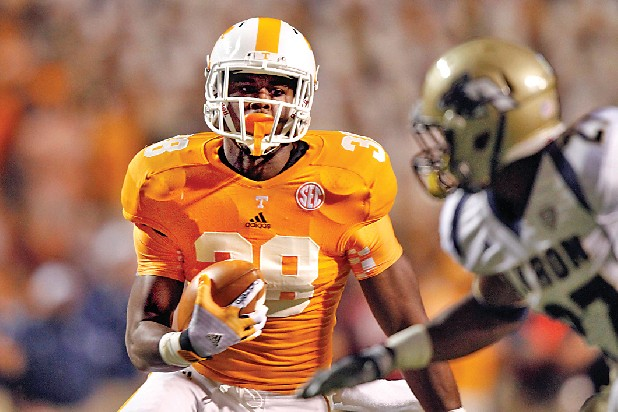 Tennessee Vol fullback Justin King (38) runs for yardage during the first half of an NCAA college football game between Akron and Tennessee in Knoxville.