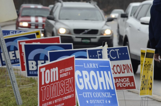 Campaign signs line East Brainerd Road in front of the polling place at Concord Baptist Church as voting takes place Tuesday in Chattanooga's municipal election.