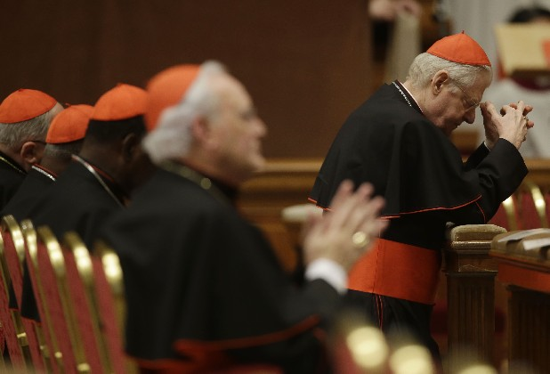Cardinals, pray during a vespers celebration in St. Peter's Basilica at the Vatican.