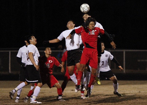 Dalton's Edgar Hernandez (15), Southeast Whitfield's Diego Nunez (6) and Israel Guttierez (12) battle for possession of the ball during the first half of play Friday evening at Dalton's home field.