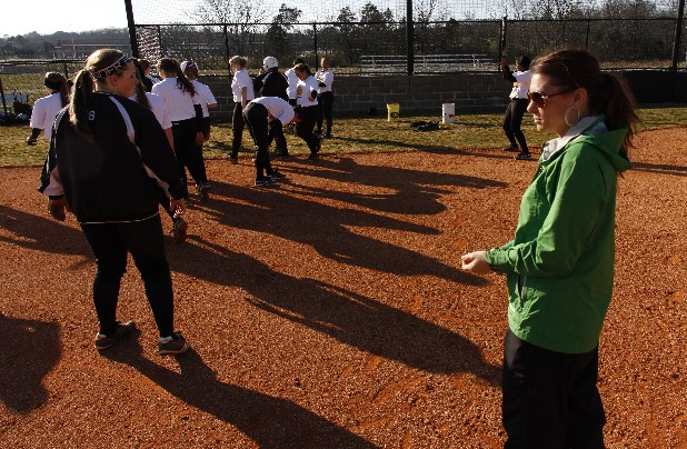East Hamilton High School softball coach Cara Stiles works with her team.