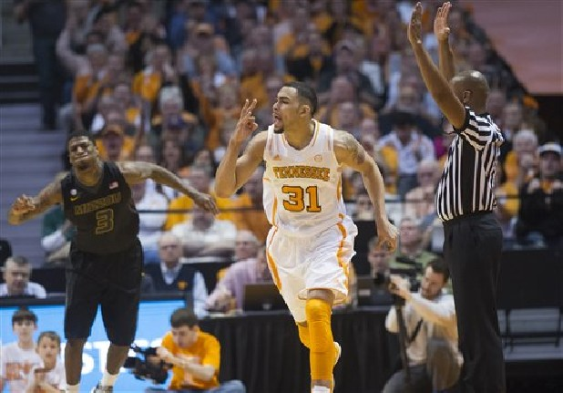 Tennessee guard Quinton Chievous (31) celebrates a 3-pointer while Missouri forward Tony Criswell (3) looks on during their NCAA basketball game Saturday at Thompson-Boling Arena in Knoxville.
