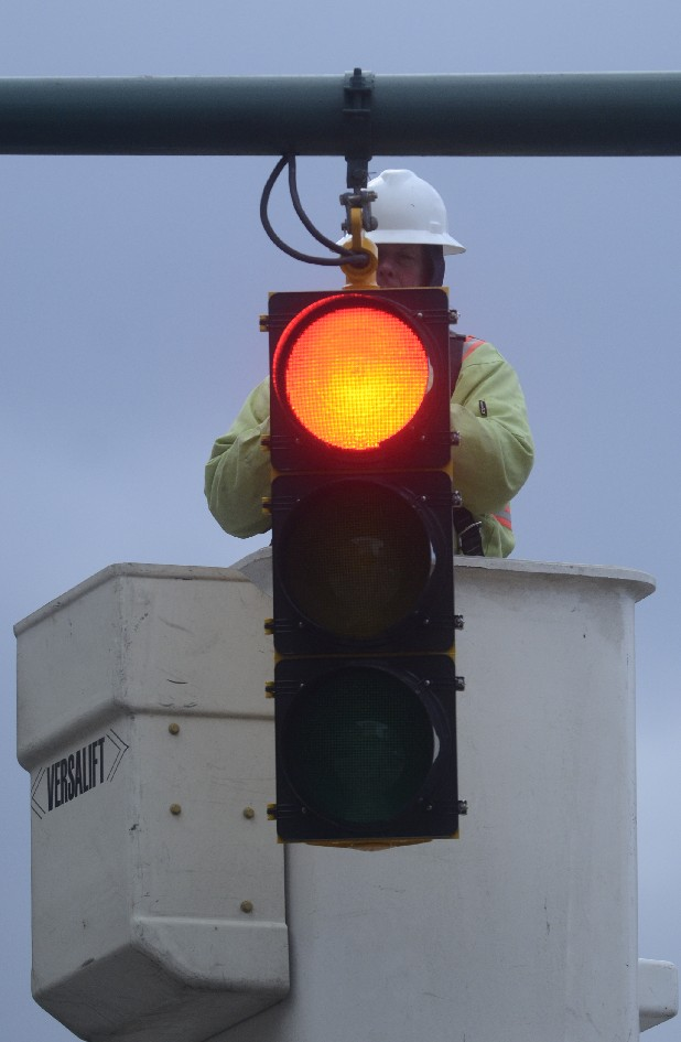 Jack Henderson finishes repairing a traffic light Wednesday at the corner of Market and 11th Streets. Henderson says the light and several others were damaged by high winds.