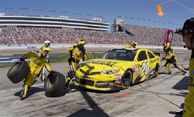 Matt Kenseth makes an early pit stop during the NASCAR Sprint Cup Series auto race, Sunday, March 10, 2013 in Las Vegas.
