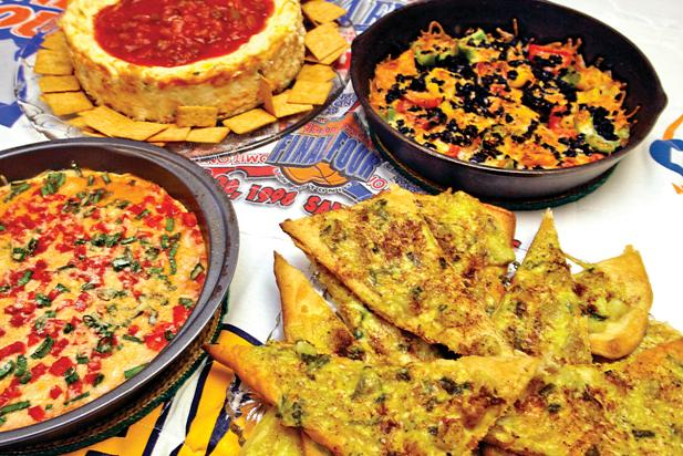Chunky Salsa Cheesecake, Rainbow Pepper Appetizer, Curried Chicken Triangles and a Hot Pizza Dip were prepared in Clint Cooper's kitchen.