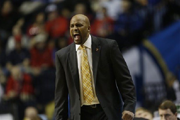 Tennessee head coach Cuonzo Martin reacts to play against Alabama during their NCAA college game at the Southeastern Conference tournament in Nashville.