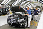 VW sales globally edge down in March, quarter