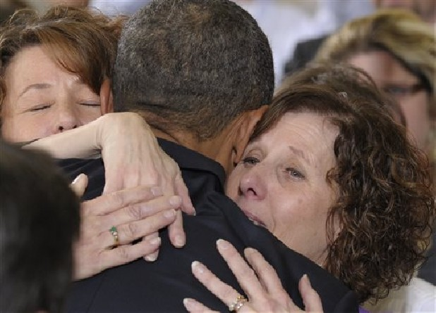 President Obama embraces Jane Dougherty, right, and Sue Connors, sisters of slain Sandy Hook psychologist Mary Sherlach.