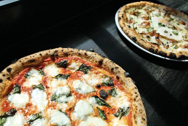 The Community Pie's Margherita Pizza is topped with San Marzano tomato sauce, fresh mozzarella, basil, extra virgin olive oil and sea salt.