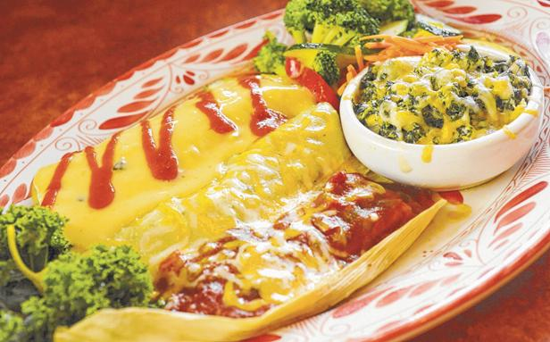 At Abuleo's, the Sonora comes with a beef burrito — topped with chile con queso — a cheese enchilada and a tamale.