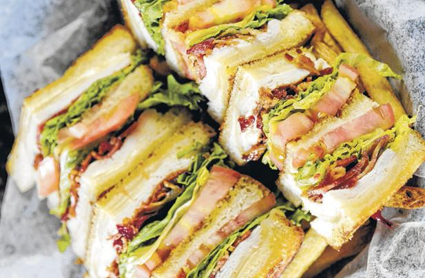 Try the club sandwich at Splitz Bar and Grill inside Pin Strikes Bowling and Laser Tag Entertainment Center.
