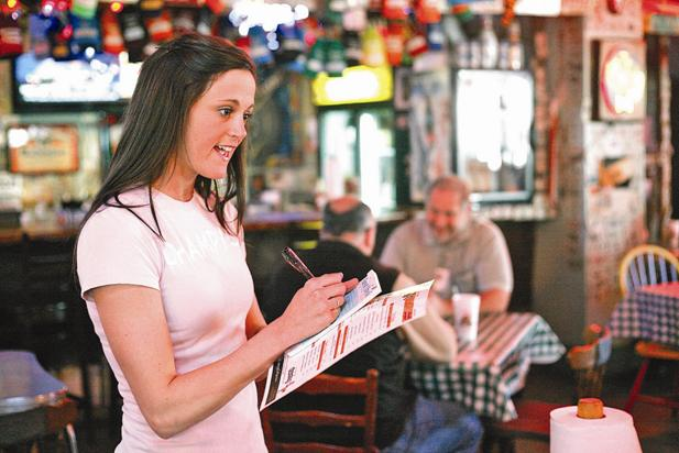 Samantha Goonan, a server at Champy's, takes an order.