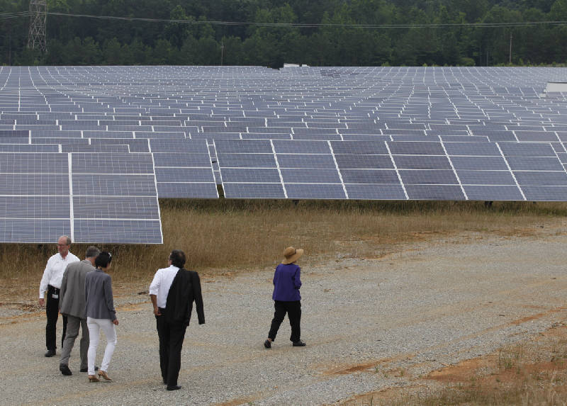 Chattanoogas volkswagen plant sets new environmental standard with people walk near solar panels arranged in line on 33 acres of property wednesday at the chattanooga volkswagen plant in chattanooga malvernweather Images