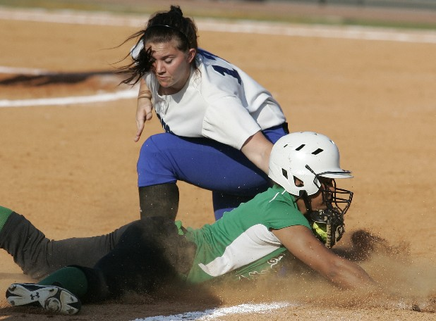 Tennessee All-Star softball team member Shaliyah Geathers, of East Hamilton High School, is tagged by Georgia's Erika Bynum, of Ringgold, Ga., during the local Tennessee-Georgia All-Star softball game Wednesday afternoon at Frost Stadium in Chattanooga.