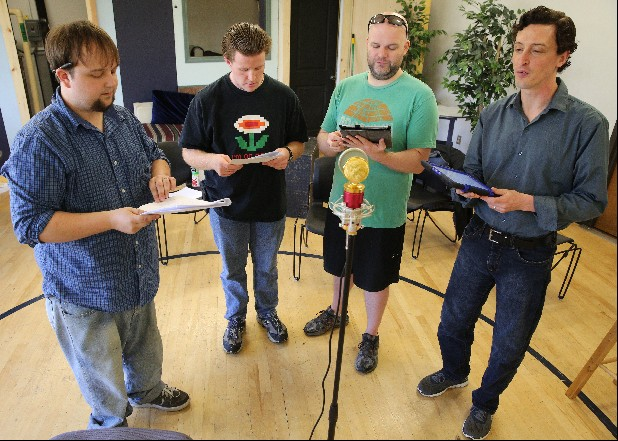 "Dakota Brown, the voice of Horace Kentucky; Eric Wyatt, the voice of Attila the Hun; Andrew Woomer, the voice of Death; and Jeffrey Parker, the voice of War, from left, record an episode of the podcast ""Horace Kentucky's Chronal Detective Agency."""