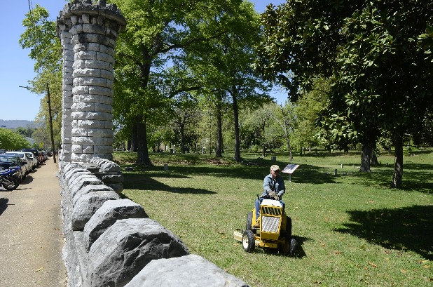Herb DeLoach, of the Sons of Confederate Veterans, mows the grass Wednesday at the Chattanooga Confederate Cemetery, located in between the campuses of the University of Tennessee at Chattanooga and the Chattanooga School for the Arts and Sciences.