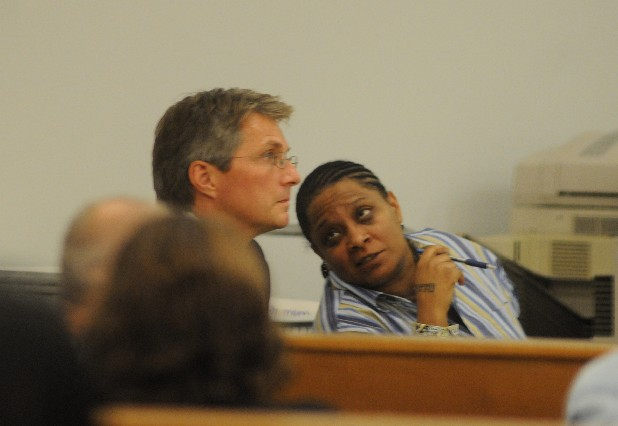 Twanna Blair, right, talks to her attorney, Lee Davis, in this photo from her 2009 trial in Bradley County.