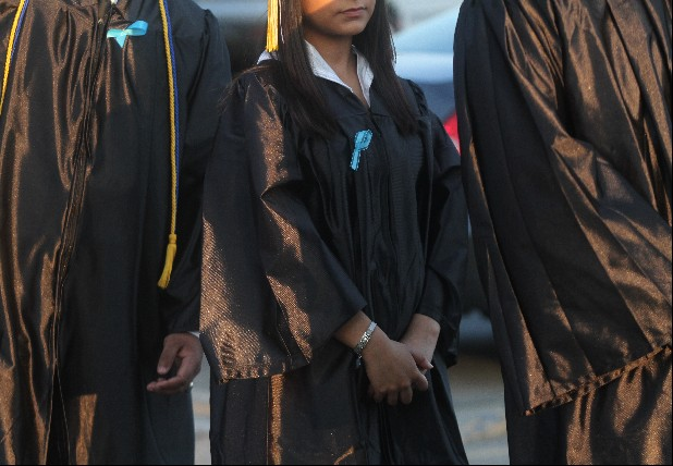 Students await graduation at Calhoun High School on May 23, 2014 in Calhoun, Ga. Blue ribbons were worn in support of one Calhoun senior who was allegedly raped by three of her classmates.