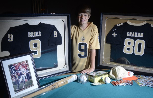 Blaine Savage, 11, has been collecting autographed sports memorabilia for several years.