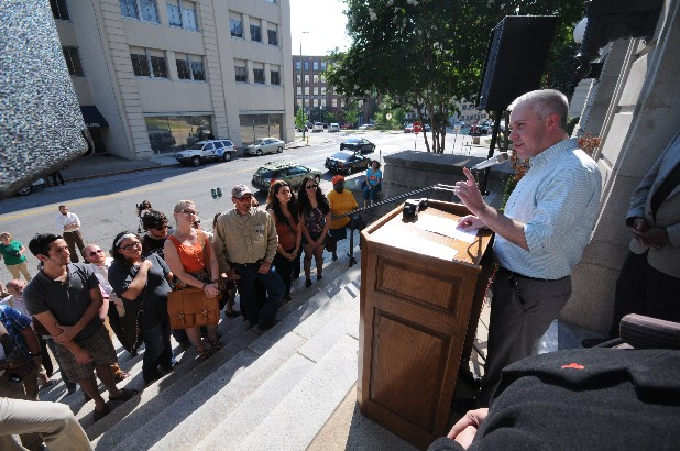 City Commissioner Chris Anderson speaks to a group from Yes Chattanooga on the front steps of City Hall in this file photo.