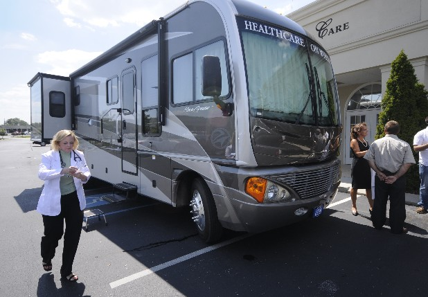 Grotefendt left walks around the healthcare on wheels mobile unit
