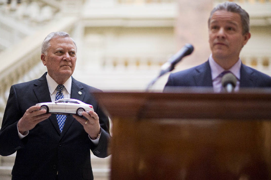 Nathan Deal, Left, Holds A Model Mercedes Benz Presented To Him By Mercedes Benz  USA CEO Steve Cannon, Right, At A Ceremony Announcing The Companyu0027s U.S. ...