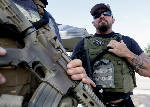 Armed citizens flock to recruiting centers to stand guard