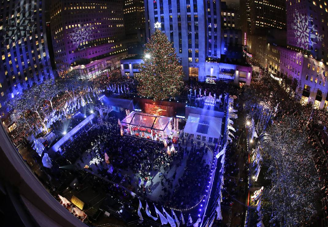 People watch as the Rockefeller Center Christmas tree is lit during a ceremony on Wednesday Dec. 2 2015 in New York. The Norway Spruce tree stands at ... & Heightened security amid Rockefeller Christmas Tree lighting | Times ...