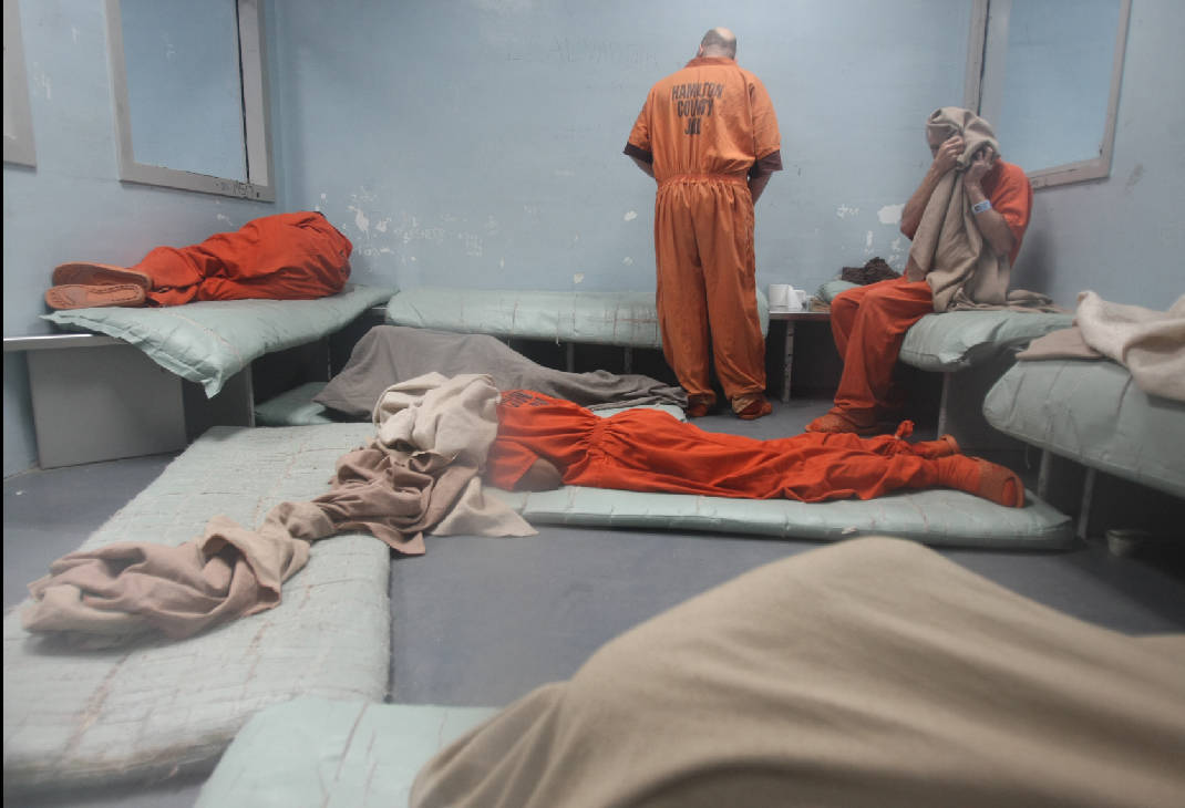 Image result for man sleeping on prison floor