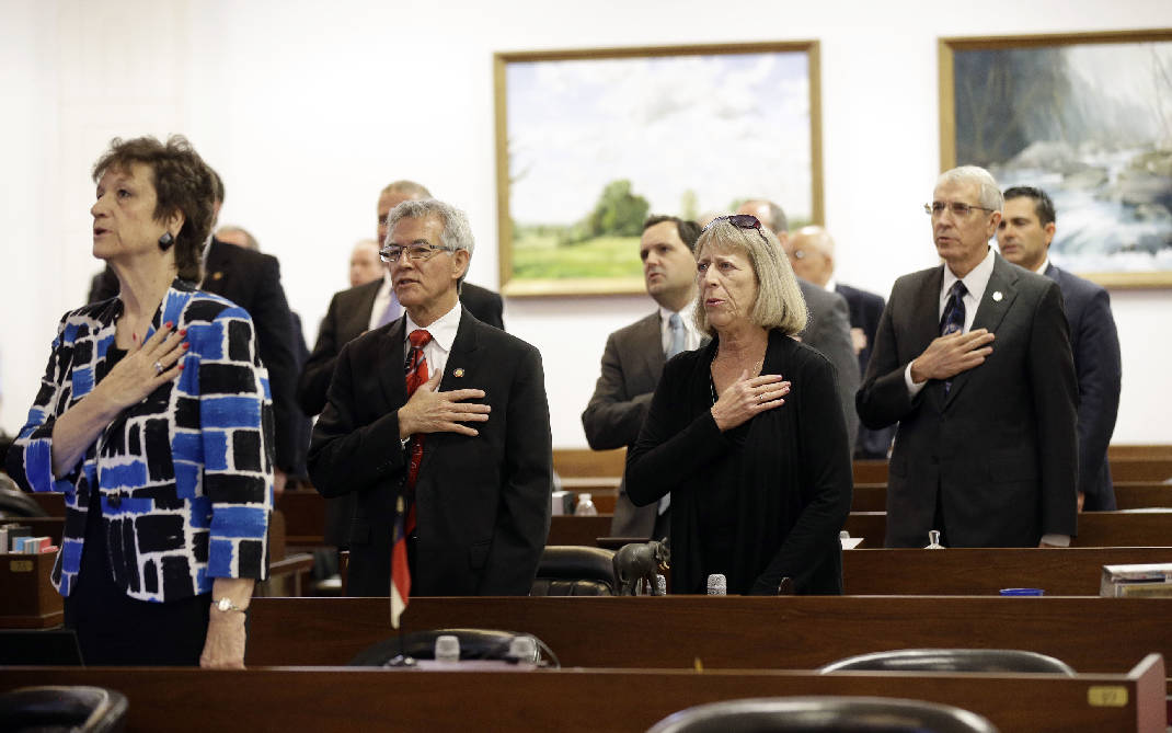 north carolina lawmakers say the pledge of allegiance wednesday march 23 2016 in raleigh nc as they gather for a special session to consider stopping a - Transgender Bathroom Law Pros And Cons