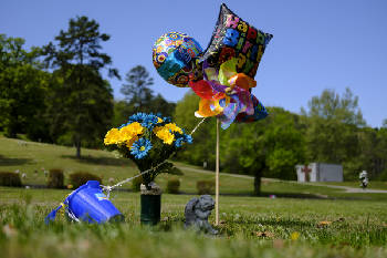 Birthday Balloons Flowers And A Pinwheel Decorate The Grave Site Of Demarcus Bryant Who Died In March 2014 From An Overdose Caused By 25 Microgram