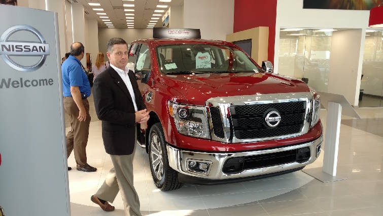 Staff Photo By Mike Pare / Kevin Gaither, A Sonic Automotive Regional Vice  President, Checks Out The New Nissan Of Cleveland Dealership.