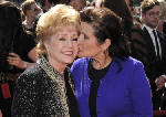 Can someone die from a broken heart? Debbie Reynolds' death brings question back to forefront