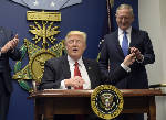 Trump signs 'new vetting measures' to guard against terror
