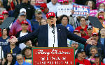 A month into presidency, Trump prepares for a campaign rally