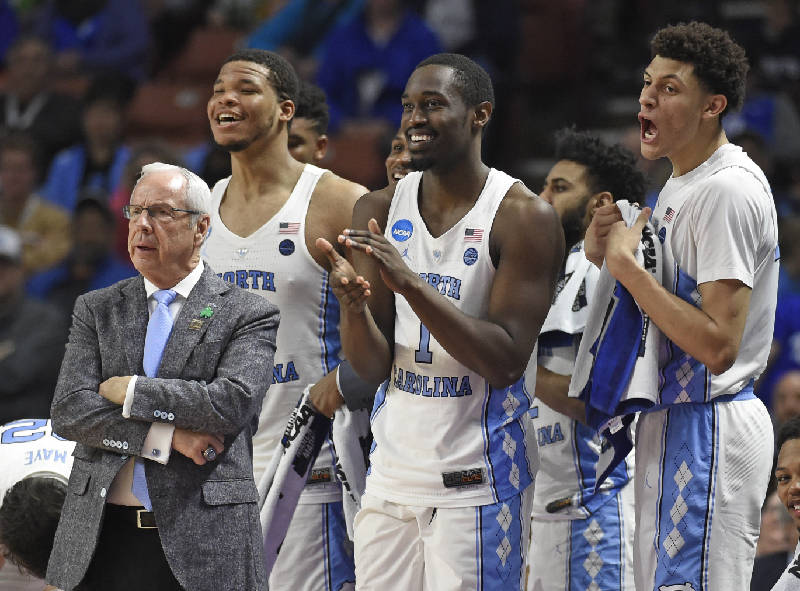 ... North Carolina head coach Roy Williams, left, and players Kennedy  Meeks, Theo Pinson and Justin Jackson react during the second half against  Texas ...