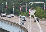 Newly donated American flags raised on Veterans Bridge to honor those who served in armed forces