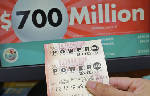The Latest: Winning numbers drawn for $700M Powerball