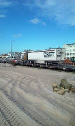 Tractor-trailer makes wrong turn, gets stuck on boardwalk