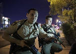 The Latest: Police search Las Vegas shooting suspect's home