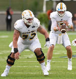 Coach Tom Arth says mostly new UTC offensive line is improving