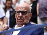 Murdoch's UK firm pays damages to ex-spy in hacking scandal