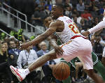 Irving, Celtics hold off Hawks in closing minutes
