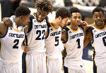 Young UTC men's basketball team winning some while learning