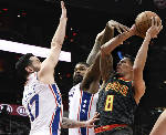76ers set team with 15th straight win, 121-113 over Hawks