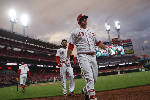 Reds rally for 1st win under Riggleman, 10-4 over Braves