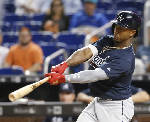 Albies hits a grand slam, Braves roll past Marlins 9-2
