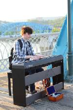 East Ridge student grows college fund through tips from piano playing all over Chattanooga