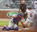 Cubs throw out 2 runner at home, rally to beat Braves 3-2
