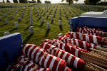 Photos: Placing flags at the National Cemetery